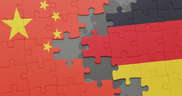 puzzle with the national flag of china and germany on a world map background. 3D illustration